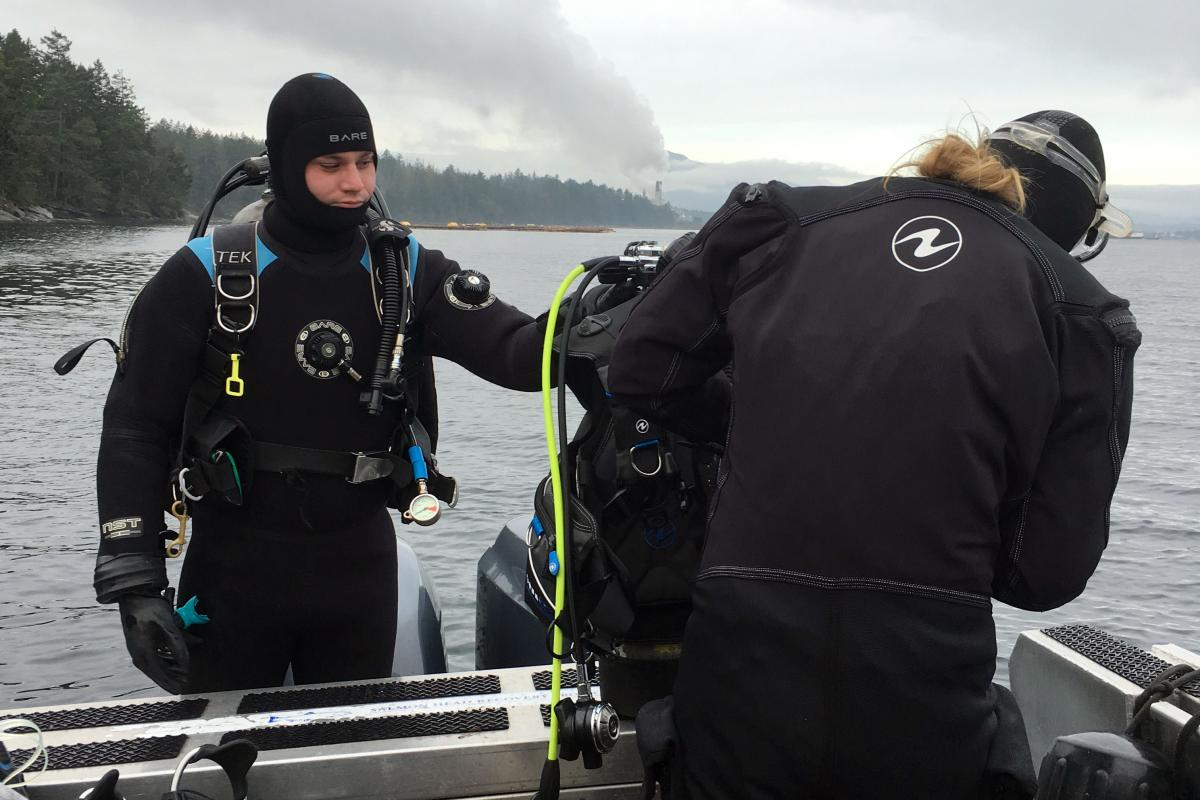 Divers, Mark Bright and Chrissy Schellenberg, prepping for their dive at the Dodd Narrows site.